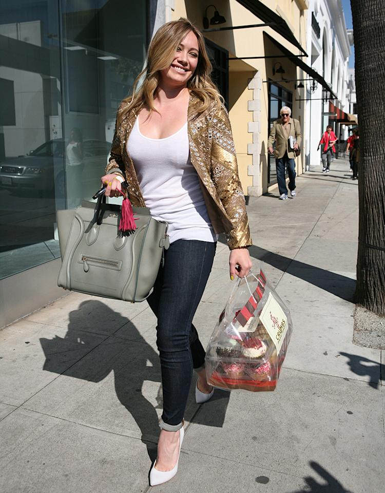 Hilary Duff buys cupcakes at Crumbs for Valentines Day in Beverly Hills, CA.