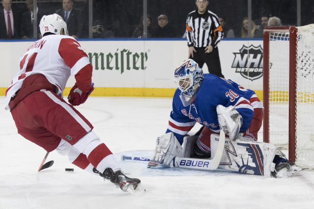 New York Rangers goaltender Henrik Lundqvist (30) makes the save against Detroit Red Wings center Dylan Larkin (71) during the first period of an NHL hockey game, Tuesday, March 19, 2019, at Madison Square Garden in New York. (AP Photo/Mary Altaffer)