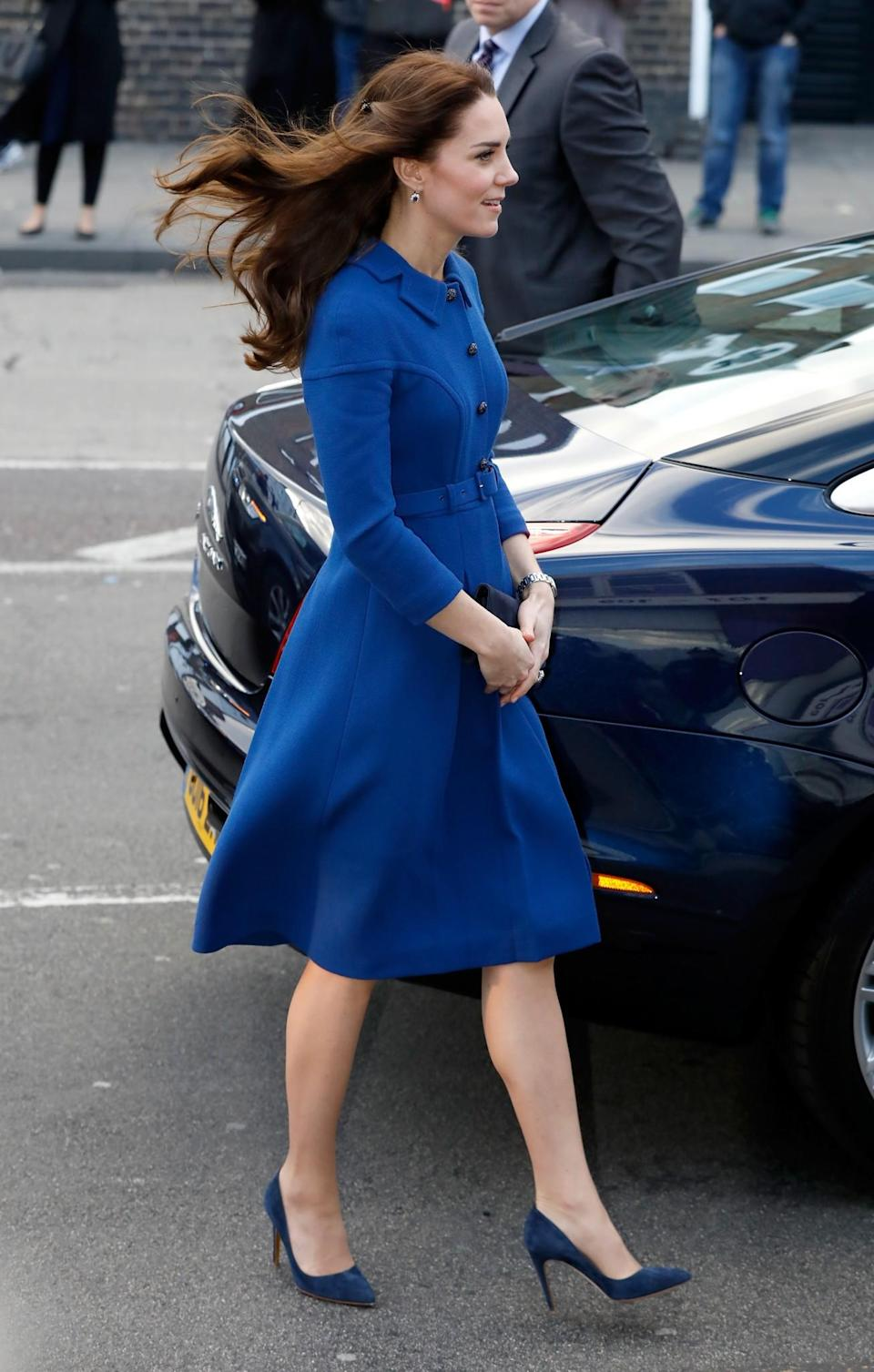 <p>For her first official appearance of the year, the Duchess donned a royal blue coat by London luxe label Eponine. Kate finished the look with her trusty Rupert Sanderson blue pumps and twisted back locks of her hair with the ultimate 90s hair accessory: the butterfly clip.<br><i>[Photo: Getty]</i> </p>