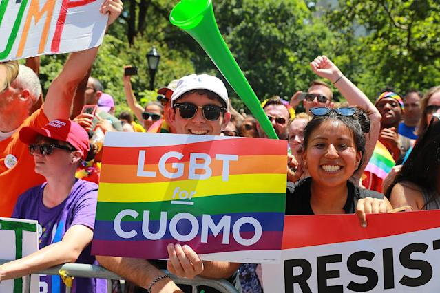 <p>People are all smiles as they hold up signs during the N.Y.C. Pride Parade in New York on June 25, 2017. (Photo: Gordon Donovan/Yahoo News) </p>