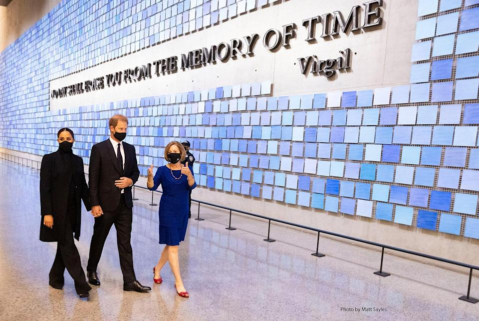 """<p>The Duke and Duchess of Sussex held hands as they were shown around the 9/11 Museum's Memorial Hall, which displays a quote by Virgil on one wall: """"No Day Shall Erase You From the Memory of Time.""""</p>"""