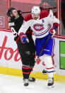 Ottawa Senators' Drake Batherson, left, gets hit by Montreal Canadiens' Jeff Petry during the third period of an NHL hockey game, Wednesday, May 5, 2021 in Ottawa, Ontario. (Sean Kilpatrick/The Canadian Press via AP)