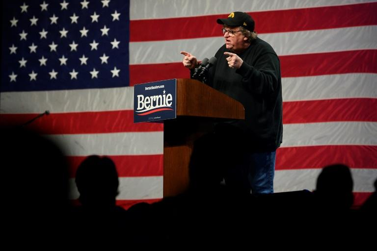 With presidential hopeful Senator Bernie Sanders stuck in Washington for the impeachment trial of President Donald Trump, filmmaker and activist Michael Moore stood in the candidate's place at a campaign event in Clive, Iowa (AFP Photo/JIM WATSON)