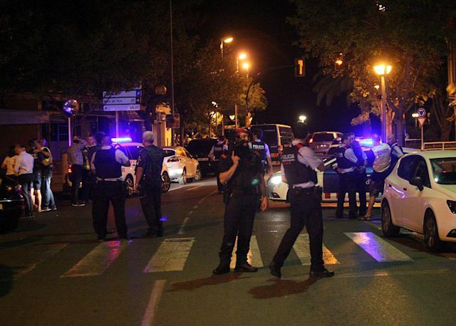 <p>Several Catalonian regional policemen cordon off the site of a shooting between security forces and alleged terrorist in the coastal city of Cambrils, northeastern Spain, Aug.18,2017. (Photo: Jaume Sellart/EPA/REX/Shutterstock) </p>