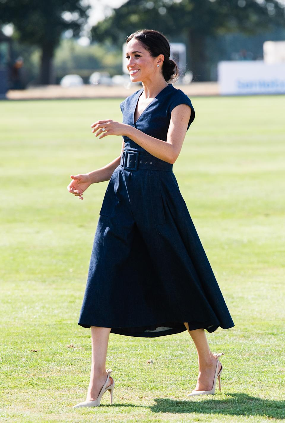 Meghan Markle wears Aquazzura heels at the Sentebale Polo event in 2018 [Photo via Getty Images]