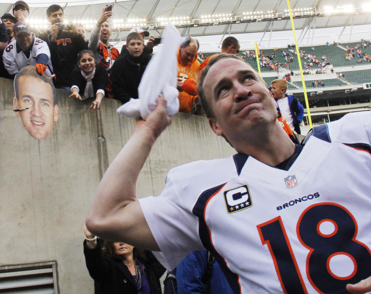 Denver Broncos quarterback Peyton Manning throws a towel into the stands after the Broncos defeated the Cincinnati Bengals 31-23 in an NFL football game, Sunday, Nov. 4, 2012, in Cincinnati. (AP Photo/Tom Uhlman)