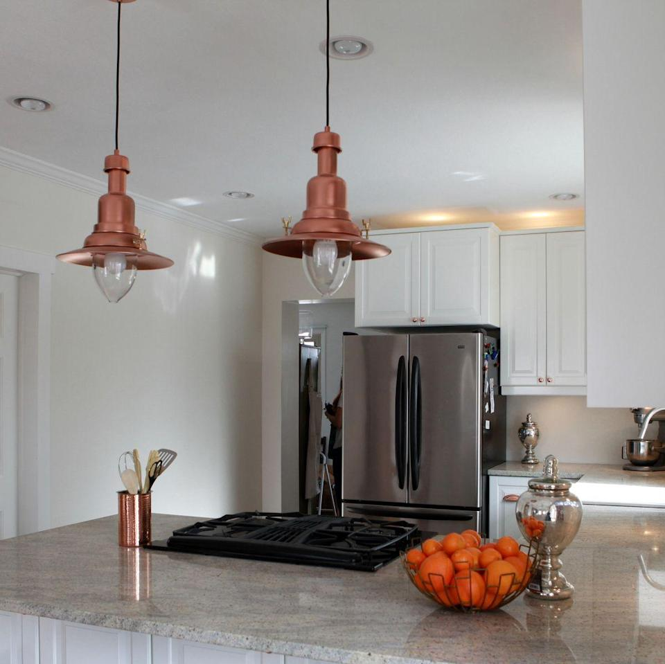 """<p>A quick coat of spray paint makes the shades look like vintage copper.</p><p>See more at <a href=""""http://kojo-designs.com/2013/01/copper-barn-light-ikea-hack/"""" rel=""""nofollow noopener"""" target=""""_blank"""" data-ylk=""""slk:Kojo Designs"""" class=""""link rapid-noclick-resp"""">Kojo Designs</a>.</p><p><em><a class=""""link rapid-noclick-resp"""" href=""""https://www.amazon.com/Martha-Stewart-Crafts-Multi-Surface-Metallic/dp/B007C7X8QW/?tag=syn-yahoo-20&ascsubtag=%5Bartid%7C2089.g.29514474%5Bsrc%7Cyahoo-us"""" rel=""""nofollow noopener"""" target=""""_blank"""" data-ylk=""""slk:BUY NOW"""">BUY NOW</a> <strong>Copper Paint, $6, <span class=""""redactor-unlink"""">amazon.com</span></strong></em></p>"""
