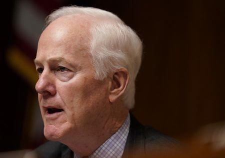 """FILE PHOTO: U.S. Senator John Cornyn (R-TX) questions Attorney General William Barr as he testifies before a Senate Judiciary Committee hearing on """"the Justice Department's investigation of Russian interference with the 2016 presidential election"""" on Capitol Hill in Washington, U.S., May 1, 2019. REUTERS/Aaron Bernstein/File Photo"""