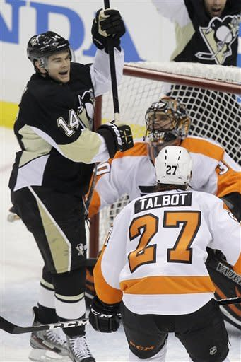 Pittsburgh Penguins' Chris Kunitz (14) celebrates his first-period goal against Philadelphia Flyers goalie IIya Bryzgalov (30) during Game 2 of an opening-round NHL hockey playoff series in Pittsburgh, Friday, April 13, 2012. (AP Photo/Gene J. Puskar)