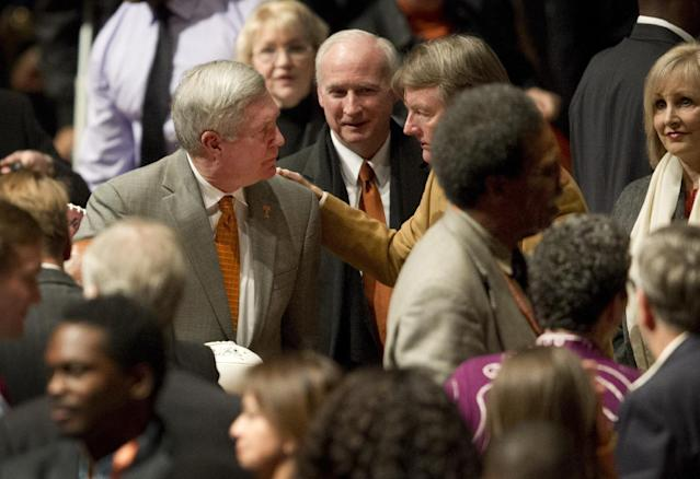 Texas head coach Mack Brown, left, talks to Texas President Bill Powers at the conclusion of the University of Texas Longhorns Honors banquet at the Frank Erwin Center in Austin on Friday Dec. 13, 2013. (AP Photo/Austin American-Statesman, Jay Janner)