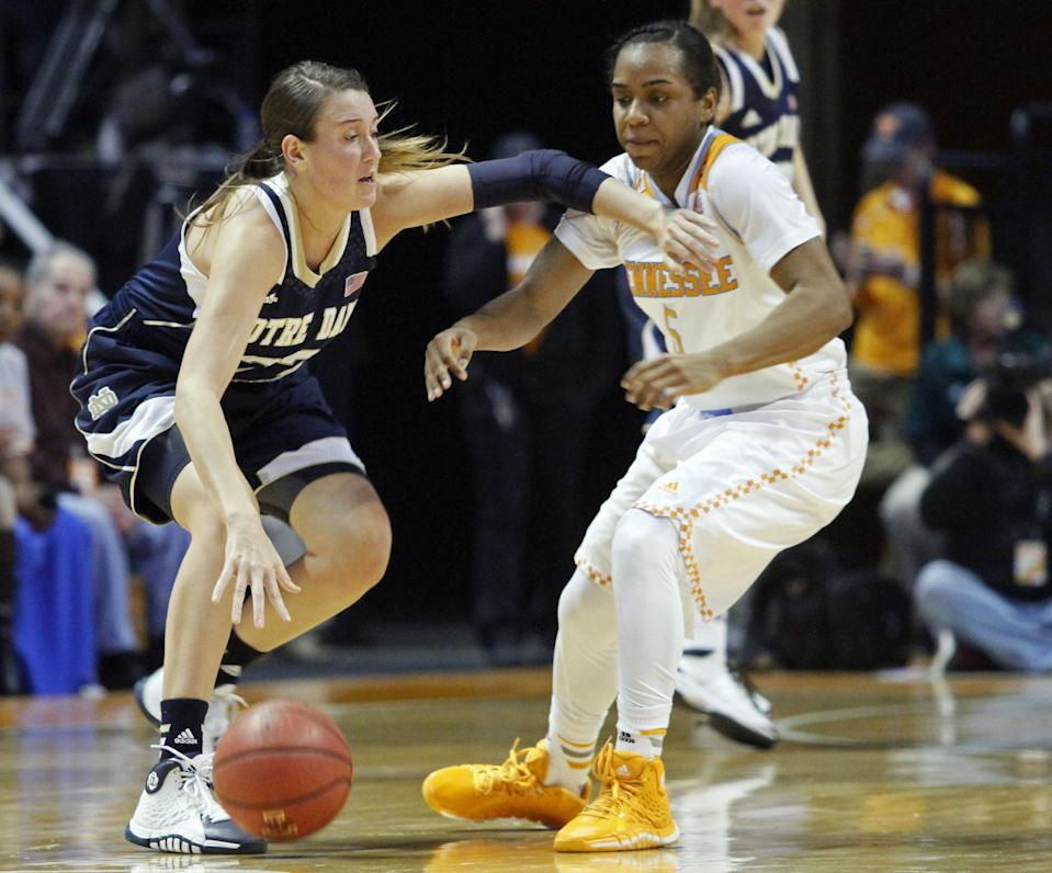 Notre Dame guard Madison Cable (22) works against Tennessee guard Ariel Massengale (5) in the first half of an NCAA college basketball game Monday, Jan. 20, 2014, in Knoxville, Tenn. (AP Photo/Wade Payne)