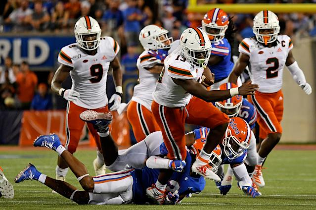 Miami Hurricanes running back DeeJay Dallas (13) breaks a tackle against the Florida Gators during the second half at Camping World Stadium. (USAT)