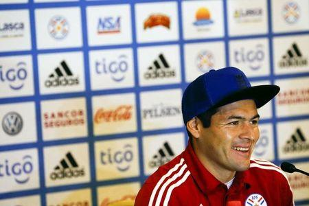 Paraguay's Pablo Aguilar smiles as he talks to the media during a news conference in Concepcion