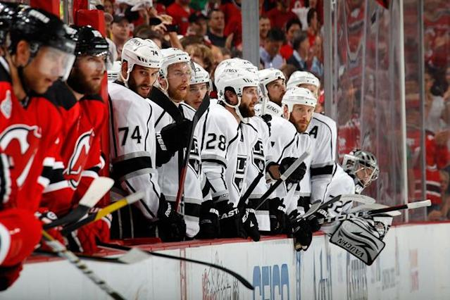 NEWARK, NJ - JUNE 09: Dwight King #74, Matt Greene #2 and Jarret Stoll #28 of the Los Angeles Kings look on late in the game against the New Jersey Devils during Game Five of the 2012 NHL Stanley Cup Final at the Prudential Center on June 9, 2012 in Newark, New Jersey. (Photo by Bruce Bennett/Getty Images)