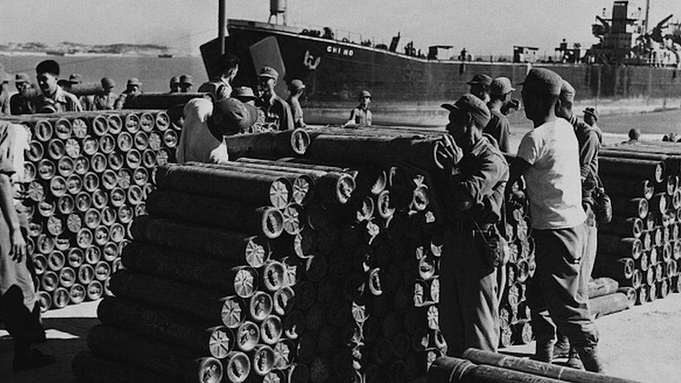 Soldiers stack artillery shells at the seaport on Quemoy to defend against communist Chinese aggression