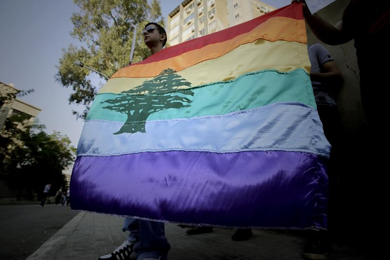 This file photo taken on April 30, 2013 shows a gay pride flag bearing the cedar tree in the middle of it during an anti-homophobia rally in Beirut