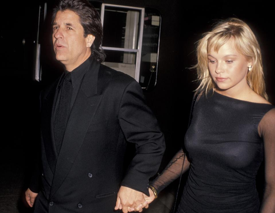 Jon Peters and Pamela Anderson attending a premiere in 1989 (Credit: Getty Images)