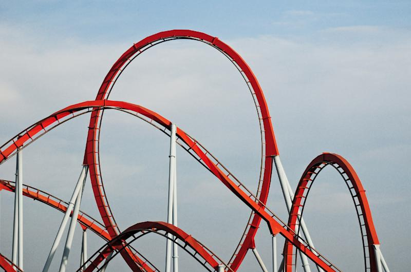 red rollercoaster in an amusement park