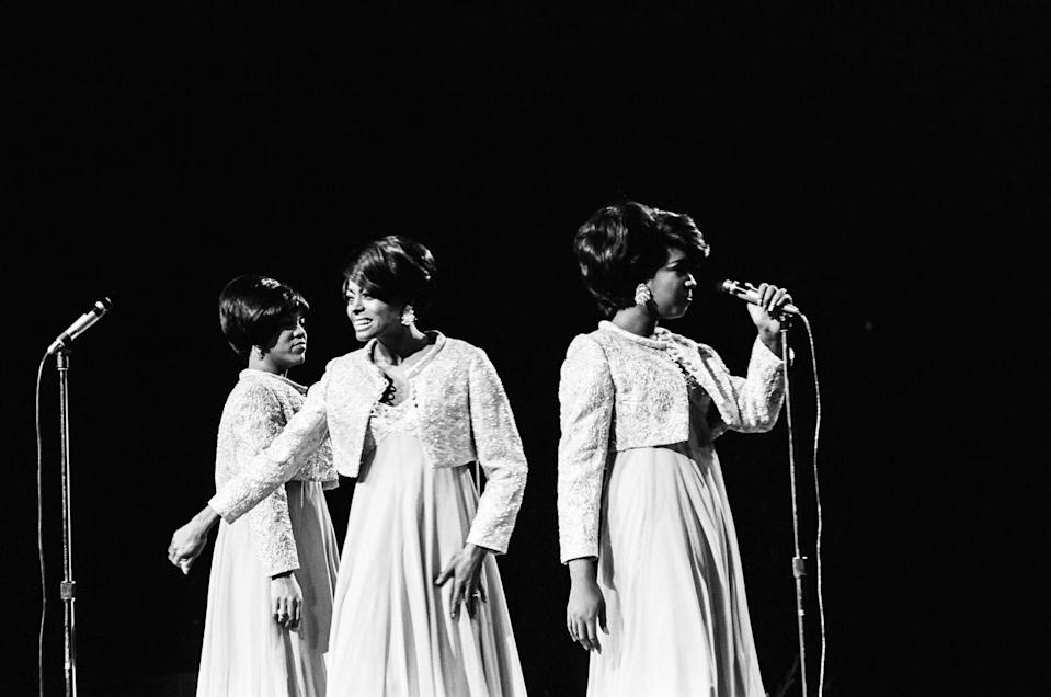 <p>Here, the Supremes look every bit the part of a synchronized pop trio, wearing full evening gowns and embellished short jackets while performing onstage in Portland, Oregon. <br></p>