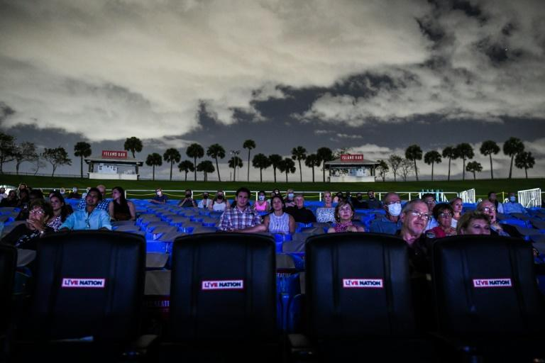 """Attendees watch """"La Boheme"""" in Palm Beach, where the company is holding a festival of pandemic-era outdoor shows"""
