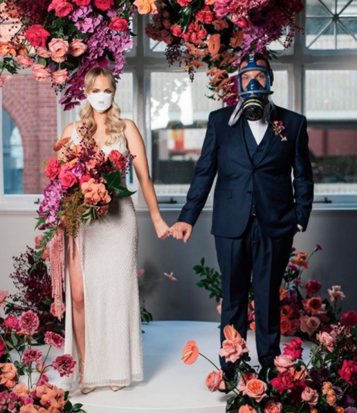 Couple getting married wearing face masks