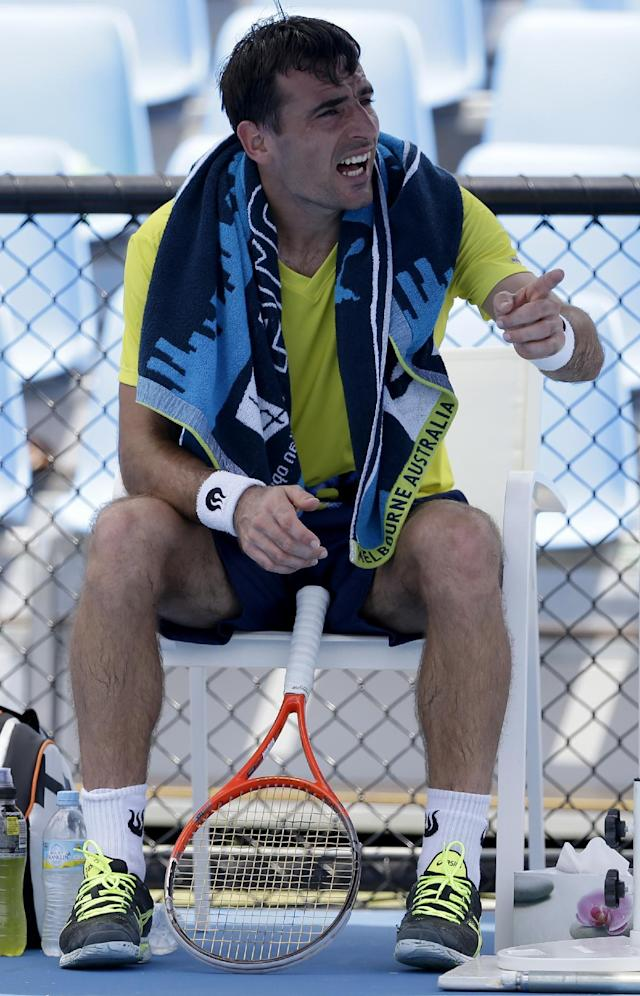 Ivan Dodig of Croatia talks to the chair umpire during his second round match against Damir Dzumhur of Bosnia and Herzegovina at the Australian Open tennis championship in Melbourne, Australia, Wednesday, Jan. 15, 2014. (AP Photo/Aijaz Rahi)