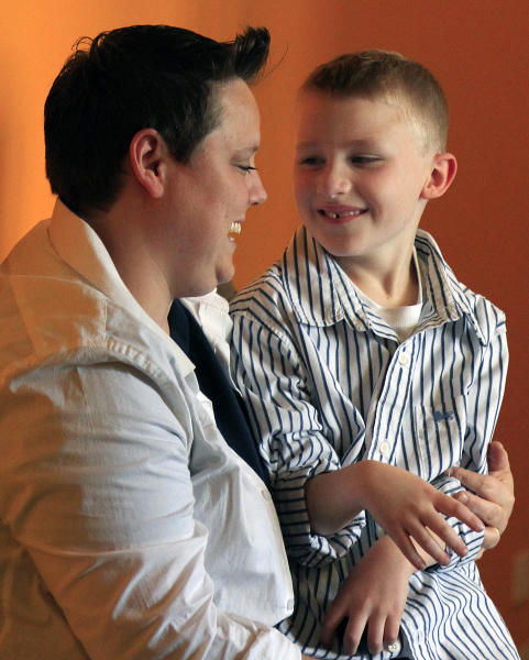 This Wednesday, April 25, 2012 photo shows Jennifer Tyrrell and her son Cruz Burns, 7, during a visit to New York. Tyrrell traveled to New York from her home in Bridgeport, Ohio, to build momentum for a petition to overturn what she says are Ohio Boy Scout's anti-gay policies, after she was removed as den leader for her son's cub scout troop. (AP Photo/Bebeto Matthews)