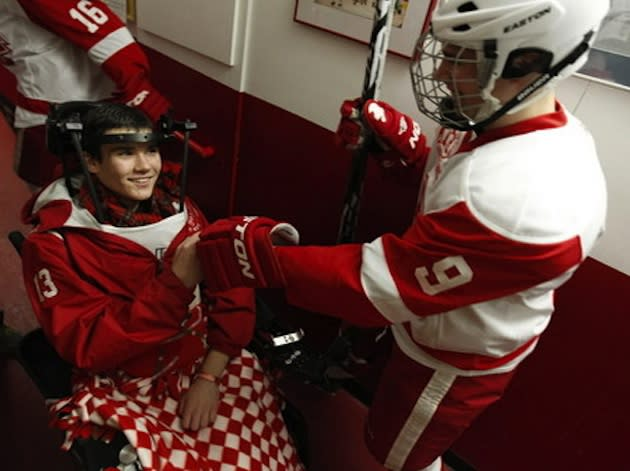 Paralyzed Benilde-St. Margaret's hockey player Jack Jablonski fist bumps a teammate — AP/The Star Tribune, Carlos Gonzalez