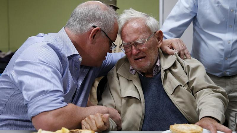 Scott Morrison put his arm around 85-year-old Owen Whalan who lost his property to fire near Taree