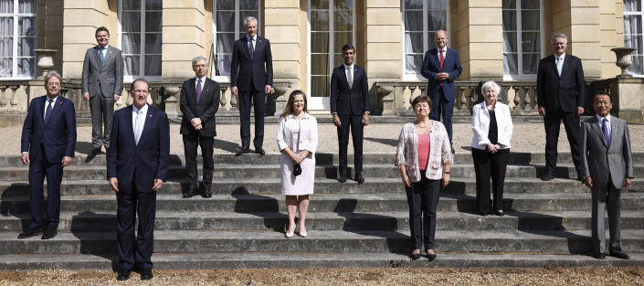 From left, EU's Economy Commissioner Paolo Gentiloni, Eurogroup President Paschal Donohoe, World Bank President David Malpass, Italy's Finance Minister Daniele Franco, French Finance Minister Bruno Le Maire, Canada's Finance Minister Chrystia Freeland, Britain's Chancellor of the Exchequer Chancellor Rishi Sunak, Managing Director of the IMF Kristalina Georgieva, Germany's Finance Minister Olaf Scholz, U.S. Treasury Secretary Janet Yellen, Secretary-General of the Organisation for Economic Co-operation and Development (OECD) Mathias Cormann, Japan's Finance Minister Taro Aso pose for a family photo as finance ministers from across the G7 nations meet at Lancaster House in London, Saturday, June 5, 2021 ahead of the G7 leaders' summit. (Henry Nicholls/Pool Photo via AP)
