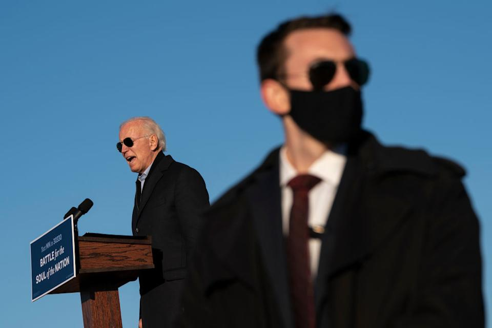 A US Secret Service agents stands watch as Democratic presidential nominee Joe Biden speaks during a drive-in campaign rally at the Minnesota State Fairgrounds in St Paul, Minnesota.