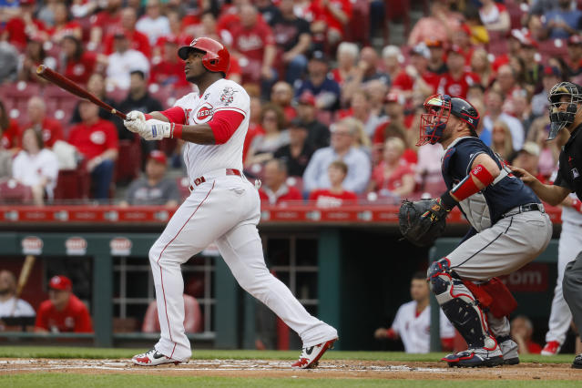 Cincinnati Reds' Yasiel Puig watches his two-run home run in the first inning of a baseball game against the Atlanta Braves, Tuesday, April 23, 2019, in Cincinnati. (AP Photo/John Minchillo)