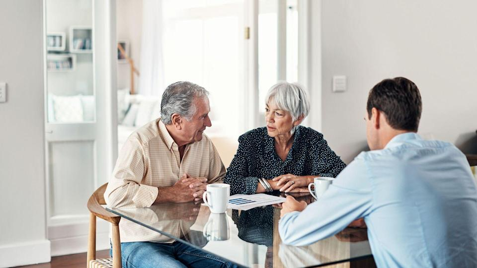 Shot of a senior couple getting advice from their financial consultant at home.