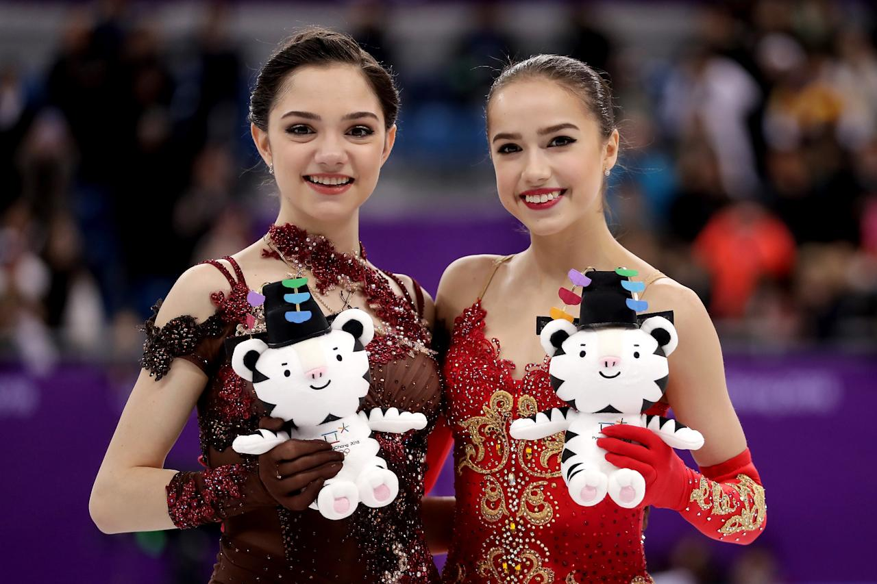 <p>Silver medal winner Evgenia Medvedeva of Olympic Athlete from Russia (L) and gold medal winner Alina Zagitova of Olympic Athlete from Russia celebrate during the victory ceremony for the Ladies Single Skating Free Skating on day fourteen of the PyeongChang 2018 Winter Olympic Games at Gangneung Ice Arena on February 23, 2018 in Gangneung, South Korea. (Photo by Richard Heathcote/Getty Images) </p>