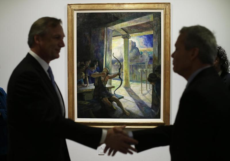 """Philadelphia Museum of Art's Timothy Rub, left, and GlaxoSmithKline's Bob Carr shake hands after viewing the N.C. Wyeth painting  """"The Trial of the Bow"""" being hung at the museum, March 5, 2013, in Philadelphia. Pharmaceutical company GlaxoSmithKline donated the painting to the museum. (AP Photo/Matt Rourke)"""