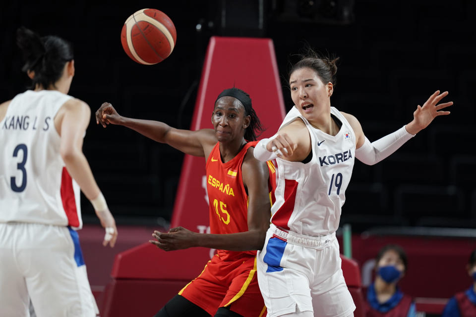 South Korea's Ji Su Park (19), right, and Spain's Astou Ndour (45) fight to take control of the ball during women's basketball preliminary round game at the 2020 Summer Olympics, Monday, July 26, 2021, in Saitama, Japan. (AP Photo/Charlie Neibergall)