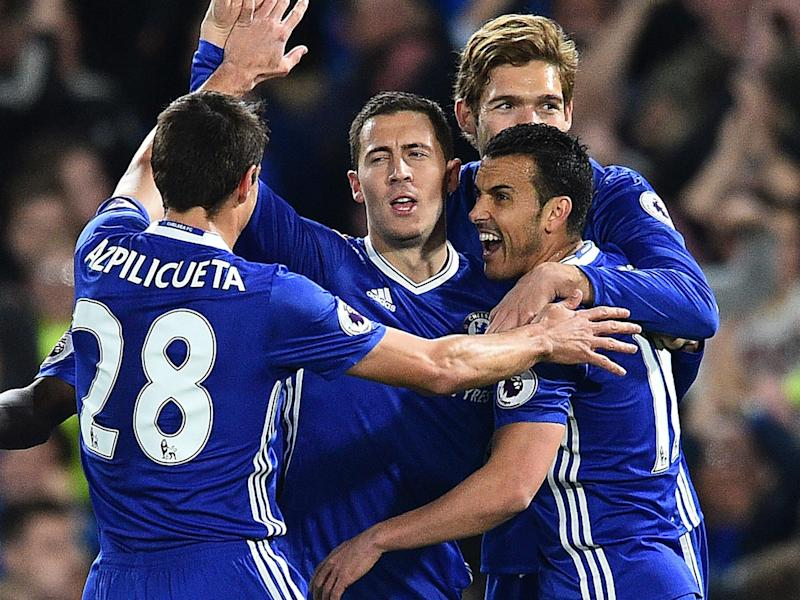 Eden Hazard scored twice as Chelsea edged closer to the title