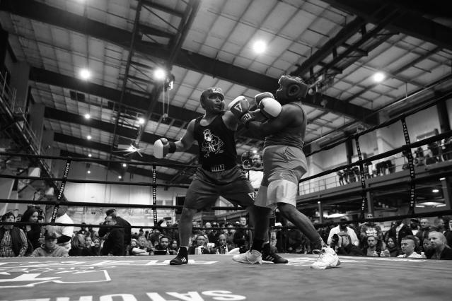 "<p>Mark Evans reaches back to throw a punch against Makesi Oliver during the ""Bronx Tough Turkey Tussle"" in the Hunts Point section of the Bronx, New York, on Nov. 16, 2017. (Photo: Gordon Donovan/Yahoo News) </p>"