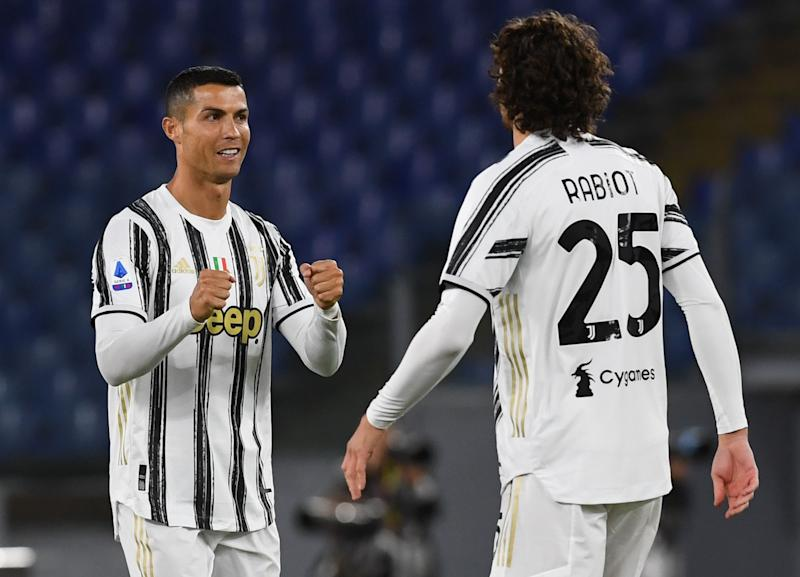 ROME, ITALY - SEPTEMBER 27: Cristiano Ronaldo(L) of Juventus greets Adrien Rabiot of Juventus(R) before the Serie A match between AS Roma and Juventus at Stadio Olimpico on September 27, 2020 in Rome, Italy. (Photo by Silvia Lore/Getty Images)
