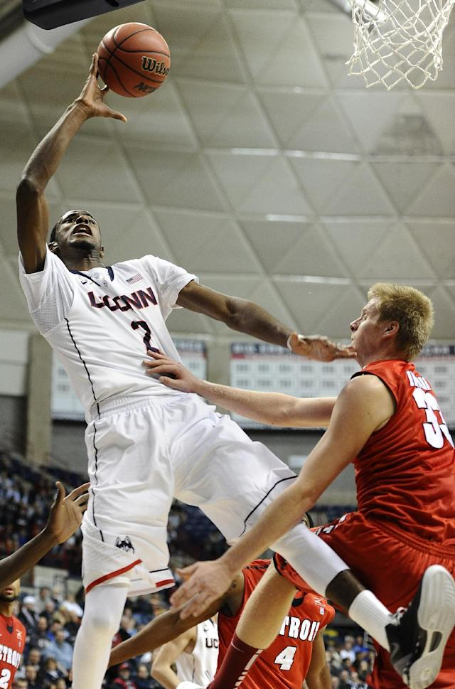 Detroit's Evan Bruinsma, right, fouls Connecticut's DeAndre Daniels during the second half of an NCAA college basketball game, Thursday, Nov. 14, 2013, in Storrs, Conn. Connecticut won 101-55. (AP Photo/Jessica Hill)