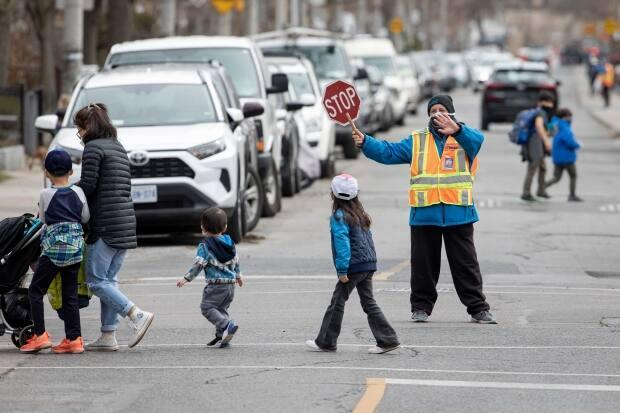 Children In Toronto head home after their last day of school on Apr. 6, 2021, when Toronto Public Health ordered all public schools to close amidst a surge of COVID-19 cases.