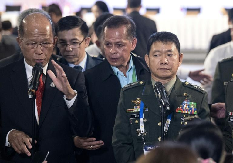 Philippine Defence Secretary Delfin Lorenzana (L) with armed forces chief Eduardo Ano (R), answers questions during a press conference in Clark