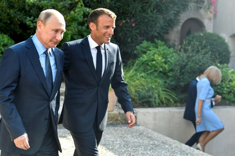 Macron and Putin agree there is a chance for peace in eastern Ukriane but clashed over Syria's civil war (AFP Photo/GERARD JULIEN)