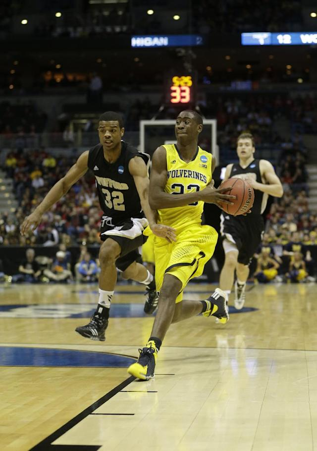 Michigan guard Caris LeVert (23) drives the ball during the first half of a second round NCAA college basketball tournament game against the Wofford Thursday, March 20, 2014, in Milwaukee. (AP Photo/Morry Gash)