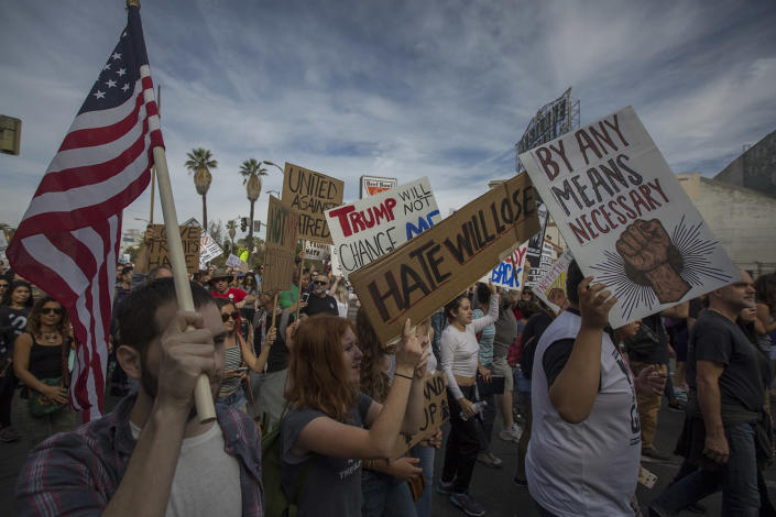 <p>Protesters march in reaction to the upset election of Republican Donald Trump over Democrat Hillary Clinton in the race for President of the United States on November 12, 2016 in Los Angeles. (David McNew/Getty Images) </p>