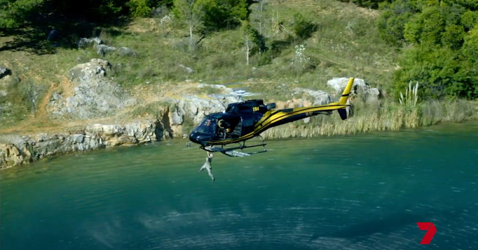 Brynne Edelston dangling from a helicopter.