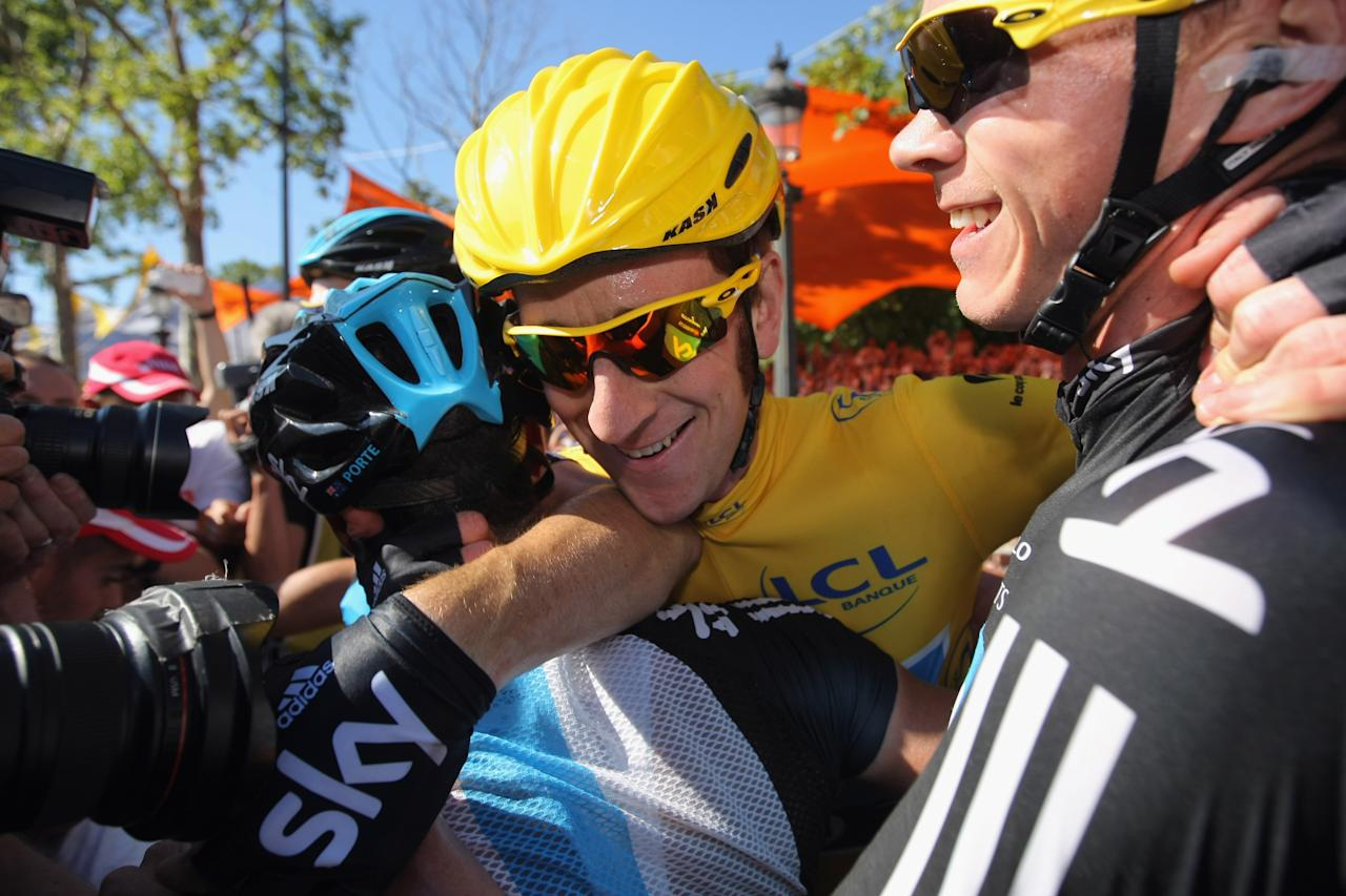 PARIS, FRANCE - JULY 22:  Bradley Wiggins of Great Britain and SKY Procycling (C) hugs teammates after winning the general classification during the twentieth and final stage of the 2012 Tour de France, from Rambouillet to the Champs-Elysees on July 22, 2012 in Paris, France.  (Photo by Doug Pensinger/Getty Images)