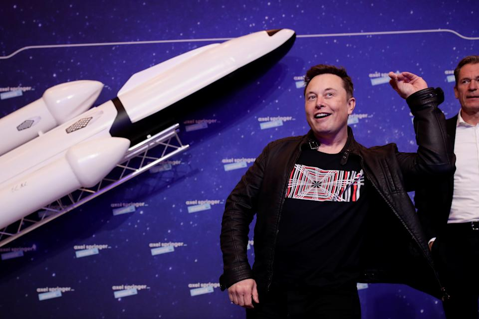 SpaceX owner and Tesla CEO Elon Musk jokes after arriving on the red carpet for the Axel Springer award, in Berlin, Germany, December 1, 2020. REUTERS/Hannibal Hanschke/Pool