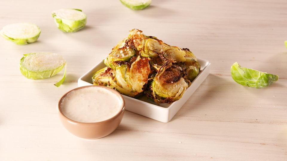 """<p>All the crunch, none of the guilt.</p><p>Get the recipe from <a href=""""https://www.delish.com/cooking/recipe-ideas/a19673558/best-brussels-sprout-chips-recipe/"""" rel=""""nofollow noopener"""" target=""""_blank"""" data-ylk=""""slk:Delish"""" class=""""link rapid-noclick-resp"""">Delish</a>. </p>"""
