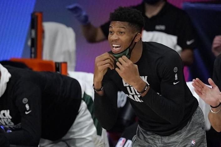 Milwaukee Bucks' Giannis Antetokounmpo shouts from the bench in the second half of an NBA conference semifinal playoff basketball game against the Miami Heat Tuesday, Sept. 8, 2020 in Lake Buena Vista, Fla. (AP Photo/Mark J. Terrill)